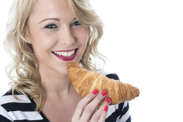 Young Woman Eating a Breakfast Croissant
