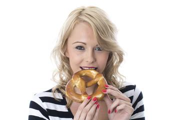 Young Woman Eating a Pretzel