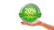 A person holding a green 20 percent discount icon