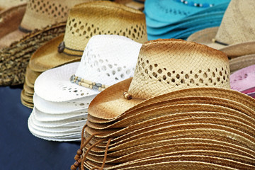 Cowboy hats of different colors lined up on table