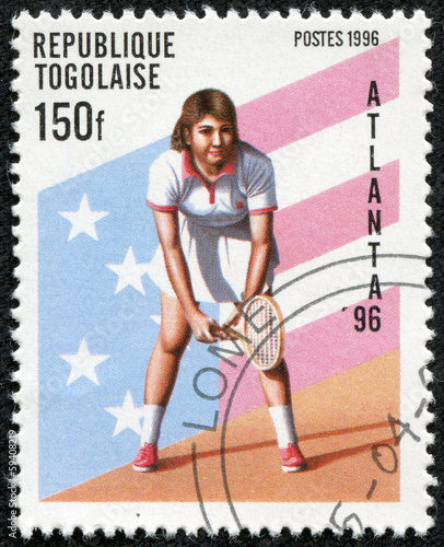 stamp printed in Togo showing female tennis player