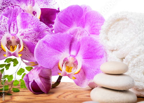 Spa still life with stone, orchid and towel