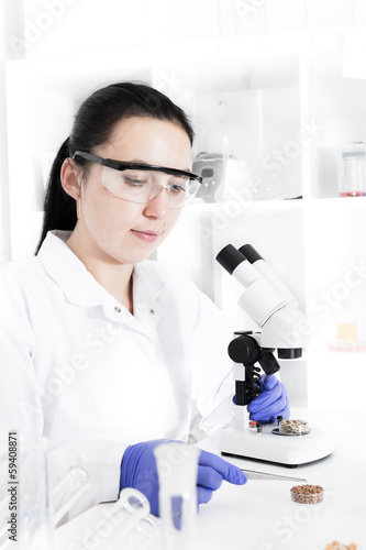 woman laboratory assistant in the laboratory of food quality