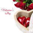 red heart in a wooden box and roses, isolated