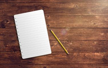 Notizblock mit Stift auf Holz Tisch