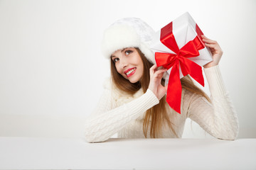 smiling woman with gift box over light background