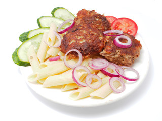 Cutlets with vegetables and pasta on a white background