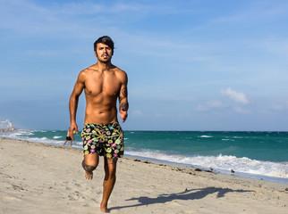 man running on the beach, in Miami beach