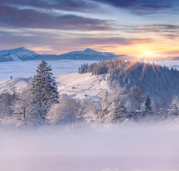 Beautiful winter sunrise in mountain village