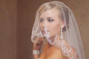 Portrait of a beautiful smiling blonde bride