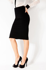 black skirt and high heel shoes