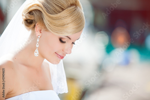 Happy bride posing in her wedding day