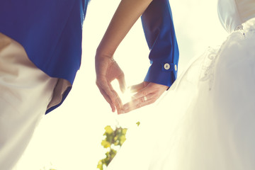 wedding couple hands touching fingers in the shape of hearts