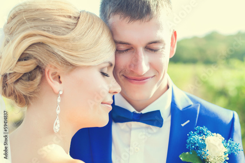 Wedding couple in summer nature close-up portrait