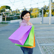 woman with colored paper shopping bags in the hand