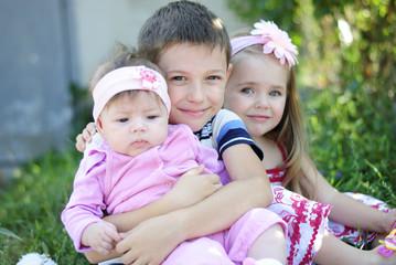 three kids near colors