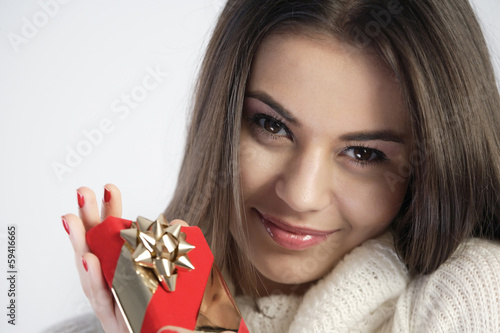 Happy girl holding a gift