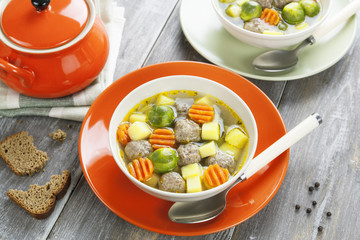 Soup with meatballs and brussels sprouts