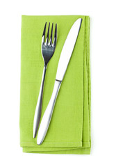 Silverware or flatware set of fork and knife on towel