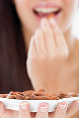 woman holding a bowl of almonds,focus on bowl