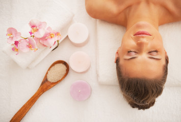 Portrait of woman laying on massage table ready for spa therapy