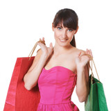 Young woman with shopping bags isolated over white