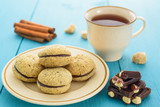 Homemade cookies, saucer, dark chocolate and tea