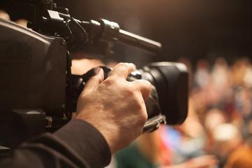 cameraman at conference