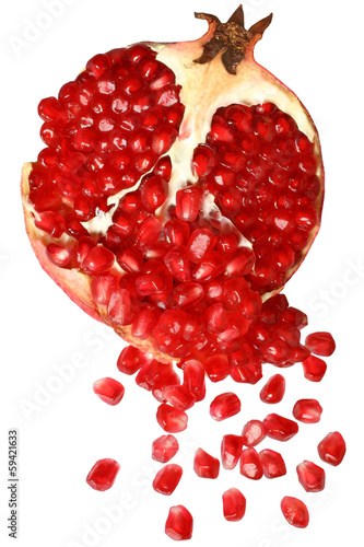 Cut the pomegranate with scattered grain top view