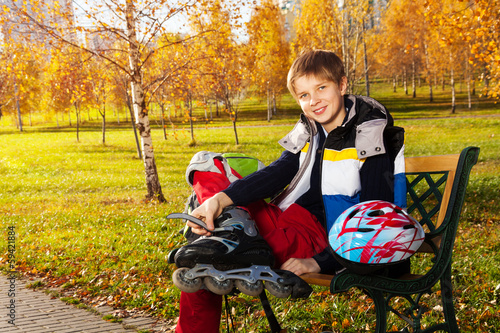 Happy boy with roller blades in the park