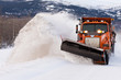 Постер, плакат: Snow plough clearing road in winter storm blizzard