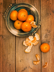 Clementines On Wooden Board