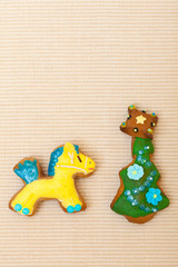 Gingerbread cake pony christmas tree icing decoration on brown