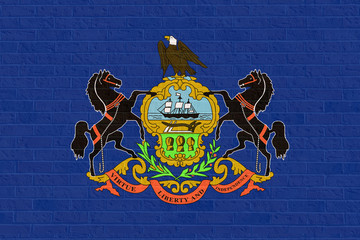 Pennsylvania state flag on brick wall