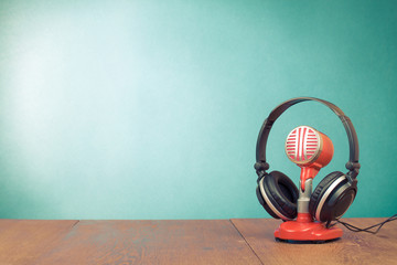 Retro red microphone and headphones front mint green background