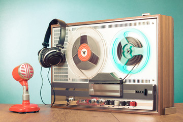 Retro reel to reel tape recorder, microphone, headphones