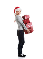 Beautiful young woman in santa hat with presents.