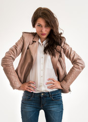 Portrait of an attractive fashionable young brunette woman hands