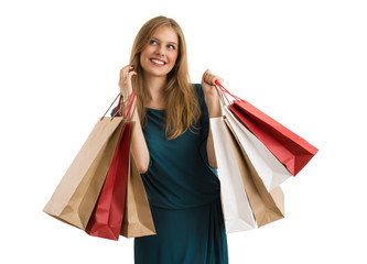Shopping woman holding shopping bags looking up