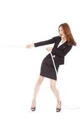 businesswoman playing tug of  war
