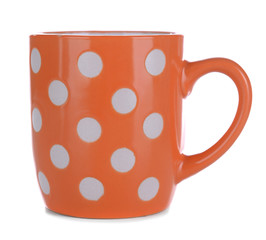 Color polka dot mug isolated on white