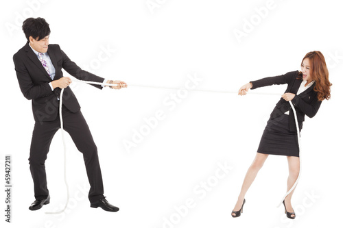 businessman and woman playing tug of  war