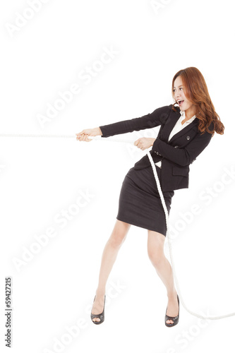 businesswoman playing tug of  war