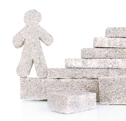 Building blocks with little man isolated on white