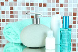Fototapety Cosmetics and bath accessories on mosaic tiles background