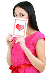 Attractive young woman with Valentine card isolated on white