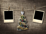 Old style photographs and Christmas tree hanging on a clotheslin