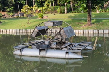 water wheel floating on the canal of park