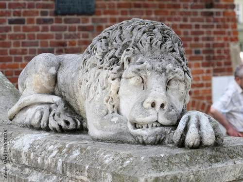 Lion sculpture near tower entrance in Krakow, Poland