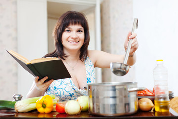 Positive woman  in kitchen